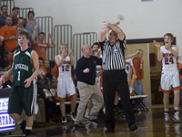 FBOA member Dave Buck signals an intentional foul in the 2010 Bridgman/Napoleon quarterfinal basketball game.