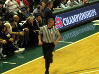 FBOA member Bruce Arter officiates a 2010 Class B Boys Semi-Final basketball game.